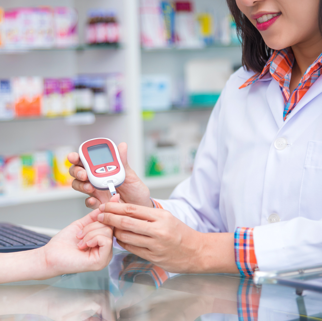 Diabetes and Exercise: Pharmacist checking Blood Sugar Level